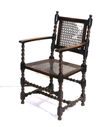 A Regency style oak armchair<br>mid 19th century