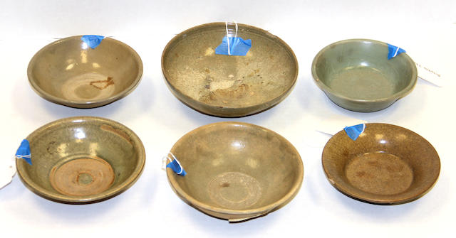 A group of six Asian celadon glazed stoneware bowls