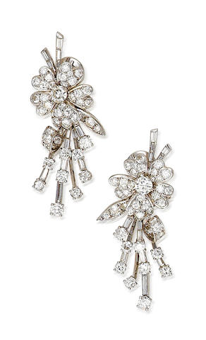 A pair of diamond pendant earclips, French,