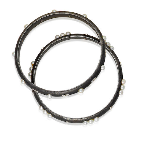 A blackened steel, cultured pearl and diamond bangle bracelet, Marsh & Co.