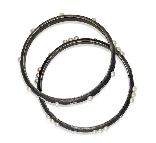 A blackened steel, cultured pearl and diamond bangle bracelet, Marsh and Co.