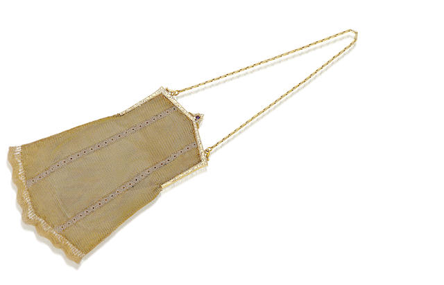 An antique fourteen karat gold purse,