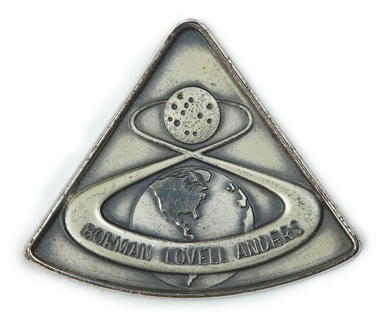 MEDALLION FROM THE FIRST LUNAR VOYAGE.