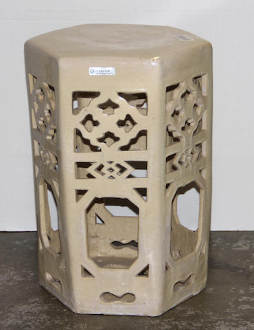 A cream glazed pottery hexagonal garden stool with reticulated sides China, Late 20th Century