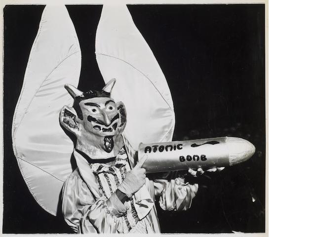 Weegee (Arthur Fellig) (American, 1899-1968); Devil with Atomic Bomb;
