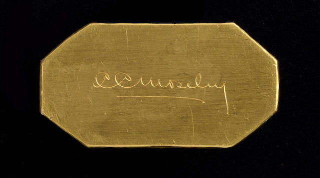 CORLISS C. MOSELEY'S GOLD PAPERWEIGHT.