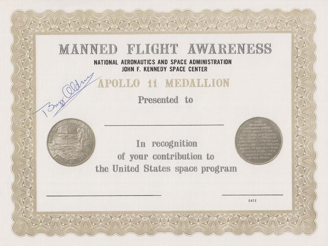 FLOWN APOLLO 11 MANNED FLIGHT AWARENESS MEDALLION.
