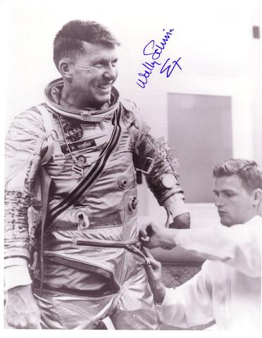 SCHIRRA IN HIS MERCURY SPACE SUIT.