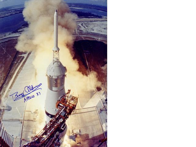 APOLLO 11 LIFTS OFF THE LAUNCH PAD.