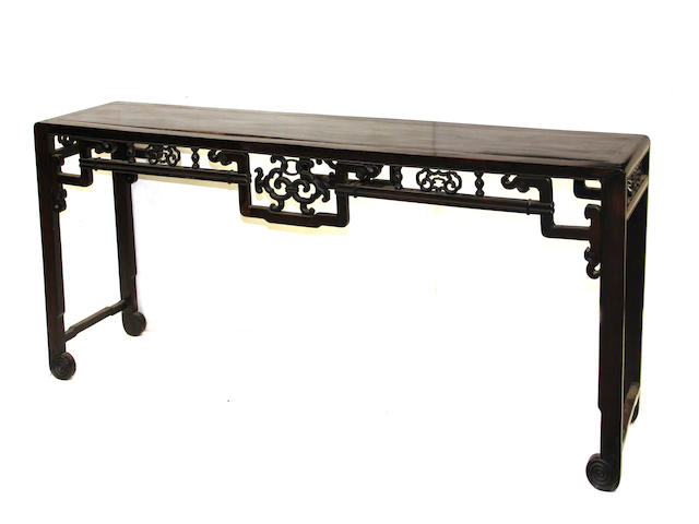 A Chinese hardwood altar table with reticulated aprons