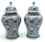 A pair of Chinese blue and white porcelain covered jars Decorated with scrolls and flowers and a Chinese blue and white porcelain jardinière
