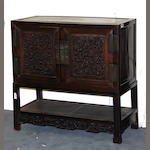 A pair of Chinese hardwood double-door chests on stands 20th Century