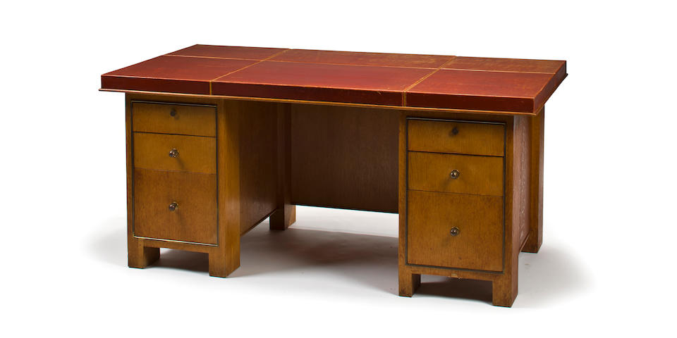 A Paul Dupre-Lafon oak and leather kneehole desk circa 1949