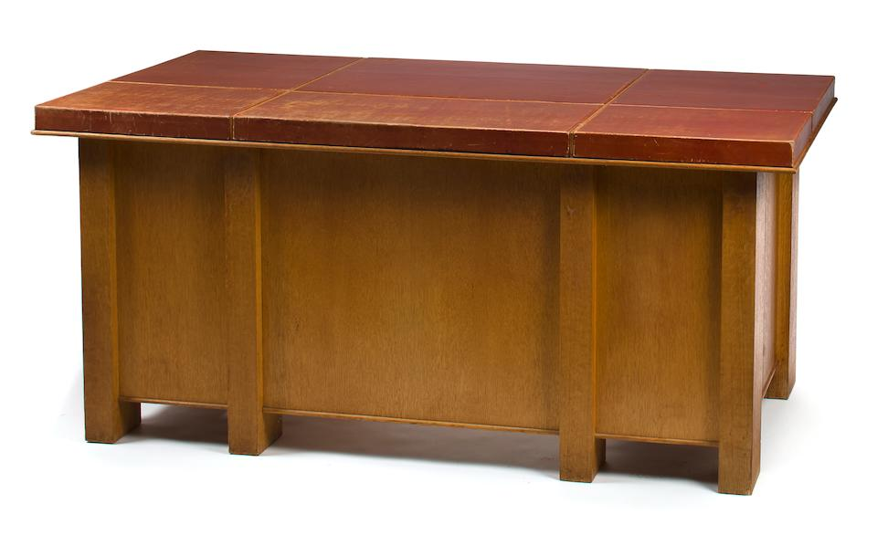 A Paul Dupré-Lafon oak and leather kneehole desk circa 1949