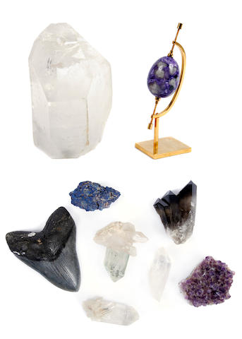 An assembled group of nine rock crystal and fossil objects
