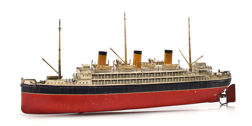 A three funnel toy ocean liner of the S.S. Bremen  Early 20th century  32-1/2 x 5-1/2 x 14-1/2 in. (82.6 x 14 x 36.8 cm.) the toy.