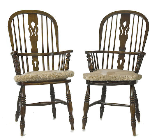 A matched set of eight George III style mixed wood Windsor armchairs