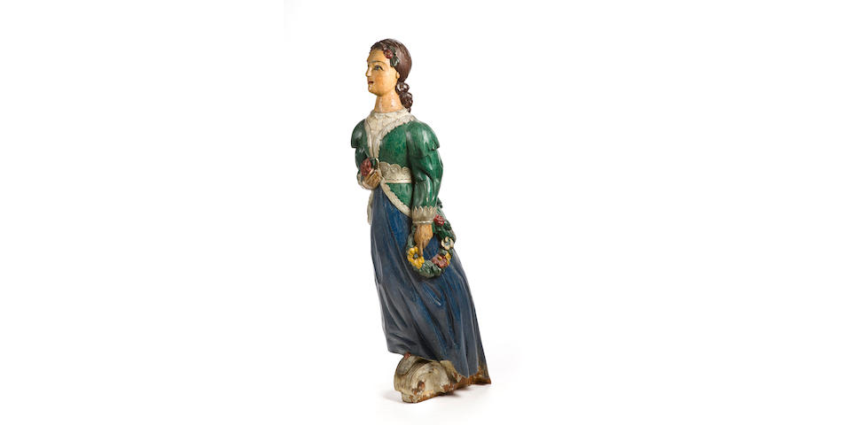 A female figurehead  58 in. (147.3 cm.) height.
