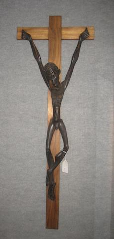 A Contemporary African carved wood crucifix signed Hginamau, 1988