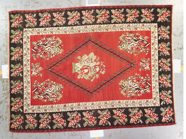 A Besarabian kilim size approximatley 8ft. 5in. x 11ft. 2in.