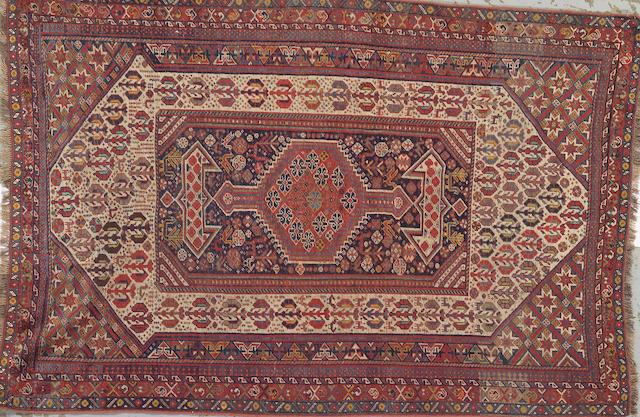 A Qashqai rug Southwest Persia size approximately 4ft. 10in. x 7ft. 1in.
