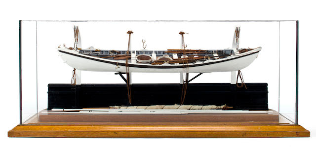 A model of a New Bedford Whaleboat  31-3/4 x 10-1/4 x 12-1/2 in. (80.6 x 26 x 31.8 cm.) cased.