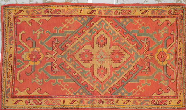 An Oushak rug West Anatolia size approximately 3ft. 8in. x 6ft. 4in.