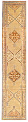 A Serab runner Northwest Persia size approximately 3ft. 5in. x 16ft. 2in.