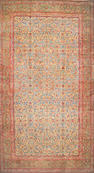 A Kerman carpet size approximately 11ft. 7in. x 20ft. 8in.