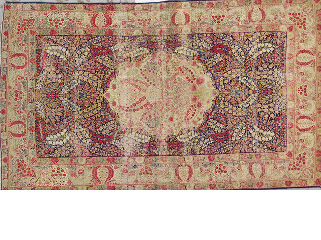 A Kerman rug South Central Persia size approximately 4ft. 5in. x 7ft. 7in.