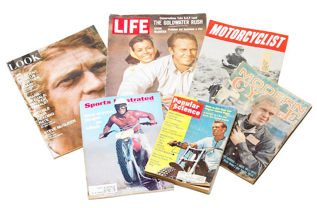 A collection of magazines featuring Steve McQueen,