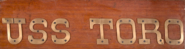 A name board for the U.S.S. Toro 11-3/4 x 43-1/2 in. (29.8 x 110.5 cm.)