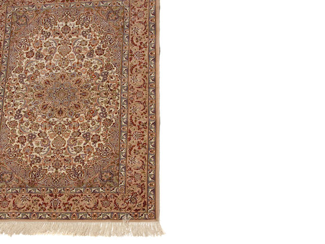 An Isphahan carpet size approximately 3ft. 6in x 5ft. 2in.