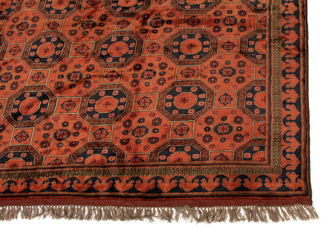 An Afghan carpet size approximately 8ft. 4in. x 10ft. 7 1/2in.