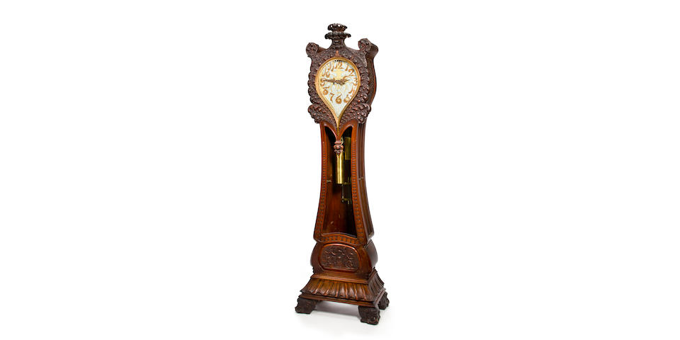 An extraordinary and unique Tiffany & Co. carved mahogany quarter chiming hall clock designed by Paulding Farnham and built in the Tiffany workshops under the supervision of Joseph Lindauer, 1887