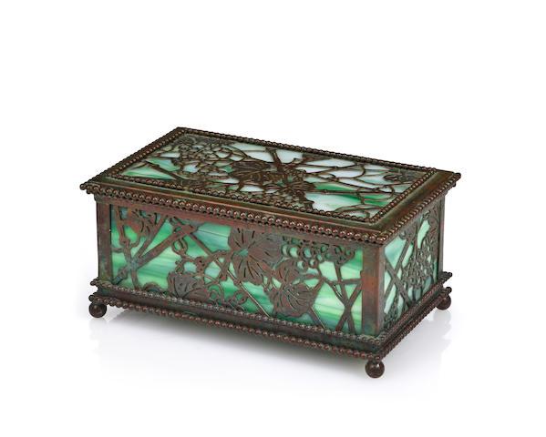 A Tiffany Studios patinated-bronze and Favrile glass Grapevine utility box 1899-1918