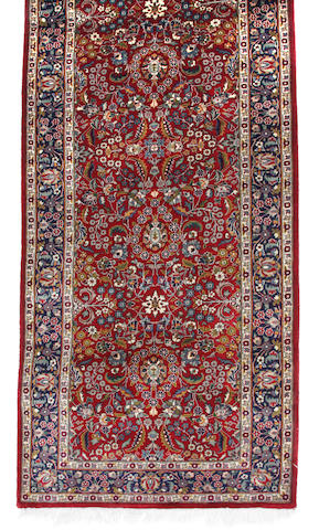 A Pakistani carpet size approximately 2ft. 7in. x 10ft. 3in.