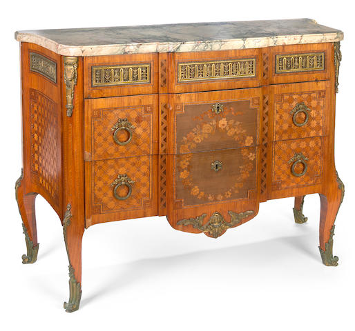 A Louis XV/XVI Transitional style gilt bronze mounted marquetry and parquetry inlaid walnut commode  first quarter 20th century