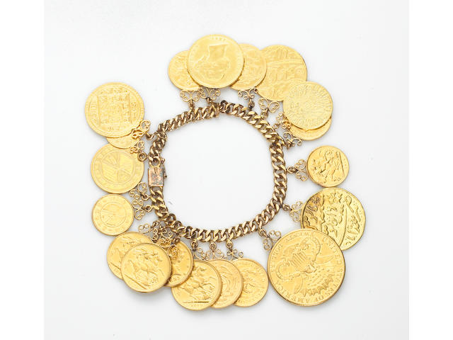 An eighteen karat gold charm bracelet suspending nineteen various world coins