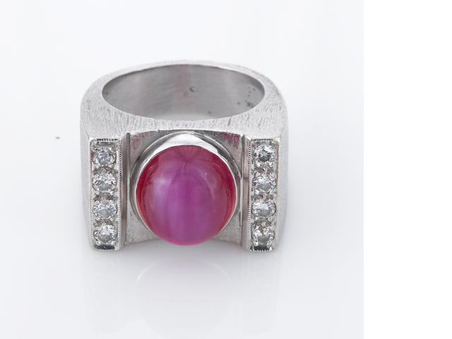 A synthetic star ruby and diamond ring