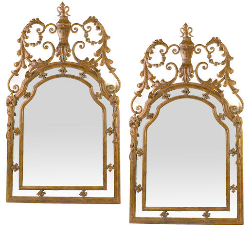 A pair of Baroque style patinated wrought iron mirrors