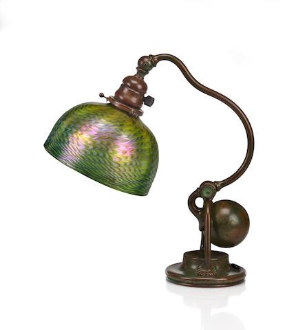 A Tiffany Studios Favrile glass and bronze counter balance desk lamp 1899-1918