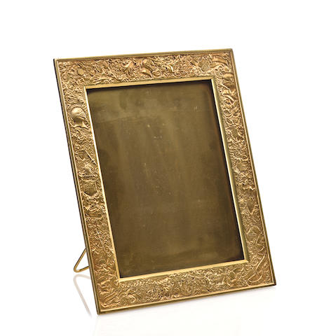 A Tiffany Studios gilt-bronze Arms and Armor picture frame 1899-1918