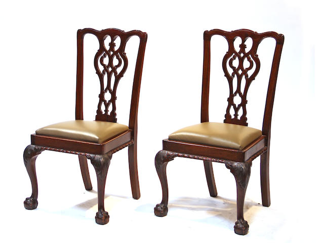 A set of four George III style carved mahogany side chairs  late 19th century