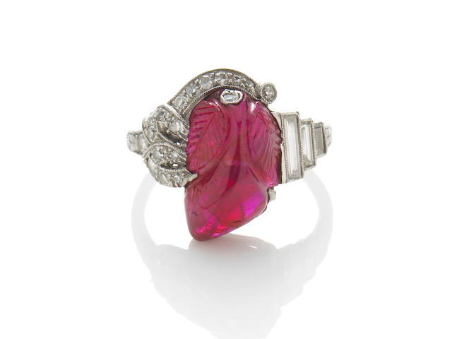 A carved ruby and diamond ring