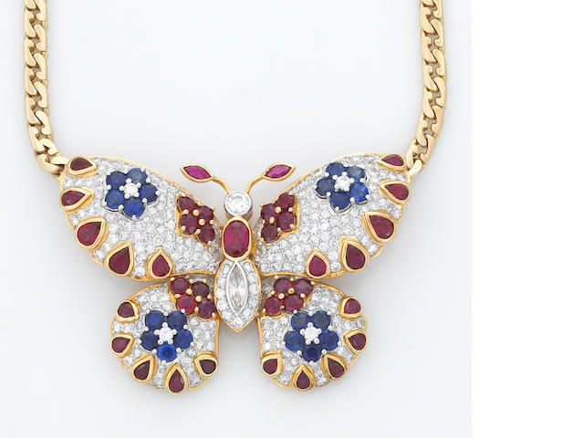 A diamond, sapphire and ruby butterfly necklace-brooch