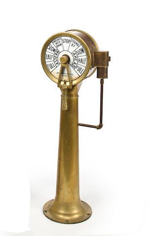 An engine telegraph  48 x 12 in. (121.9 x 30.4 cm.) height x diameter of face.