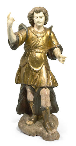 An Italian carved and polychromed figure of a saint, height 49in