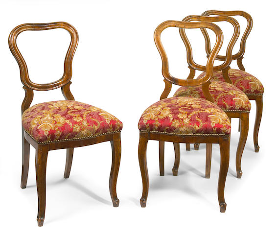 A set of four Northern Italian Rococo walnut chairs mid 18th century