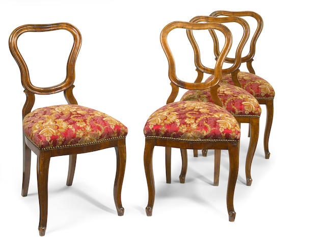 A set of four northern Italian Rococo walnut side chairs mid 18th century